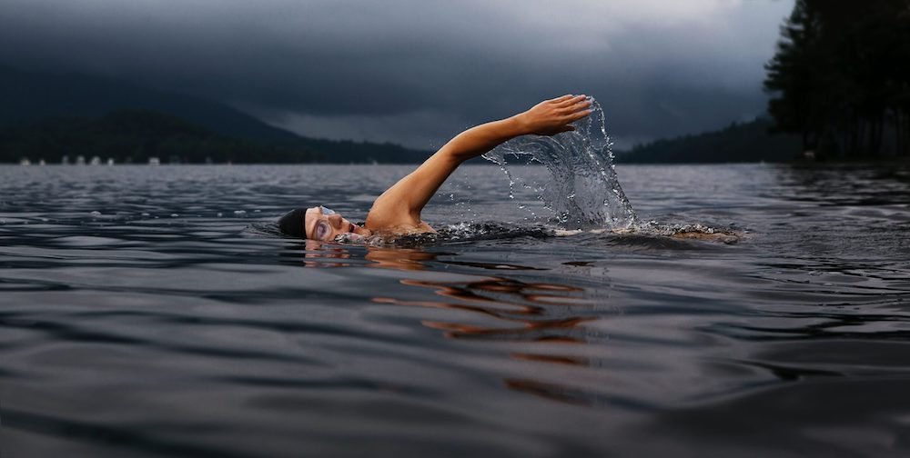 Photo of someone doing an open water swim (not me!) Photo from Unsplash by Todd Quackenbush